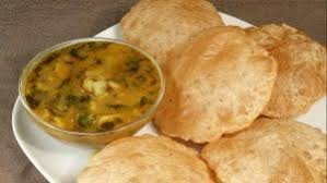 Lucchi is prepared by deep frying a roti made up of white flour, without making it crisp. It is served with a delicious potato curry. Lucchi is also known as Poori in other parts of the country.