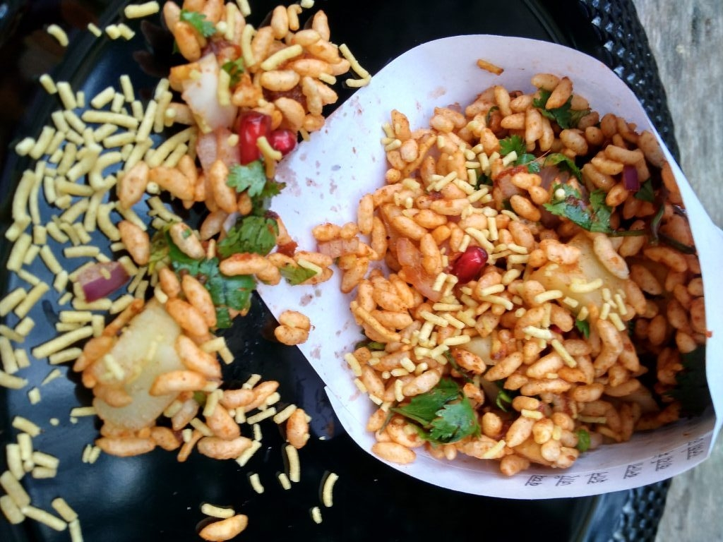 Bhelpuri is a savoury snack common in Maharashtra.It is a mixture of puffed rice, chopped onions,chopped tomatoes,tamarind chutney. Bhelpuri can be served in a lot of ways, but usually it is served on a paper which is folded in the form of a cone and is consumed using a paper spoon.