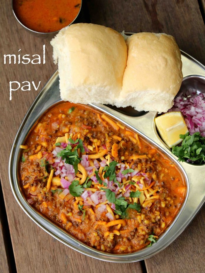 Misal pav  has a spicy and tangy lentil curry which is made with moth beans and is served with Pav bread. At times, it is eaten with yoghurt to lessen the spice.It is decorated with a slice of Lemon and Onion Coriander sprinkled on it. This street food is readily available at any street food joint and served hot.