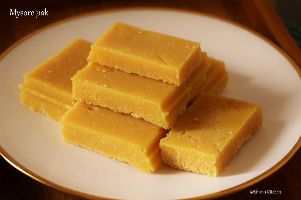 Mysore pak originally called Mysuru paaka, is an Indian sweet prepared in ghee that is popular in Southern India. It originated in Mysore in the state of Karnataka. It is made of generous amounts of ghee, sugar, gram flour. The texture of the sweet is similar to fudge.