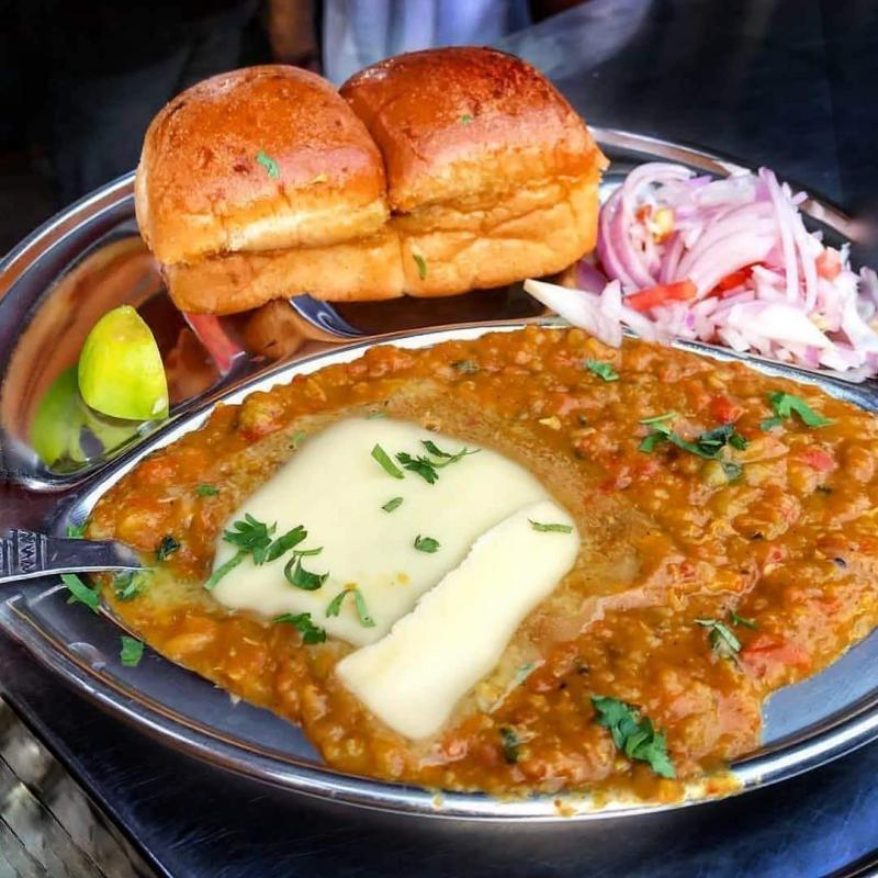 Pav Bhaji is one of the spiciest, vegetarian dish. It is a mixture of boiled vegetables along with a lot of Spices and Onion Coriander mixture for garnish.Fresh and thick slices of bread, smothered in butter served with a delicious mix of moderately spiced vegetables.